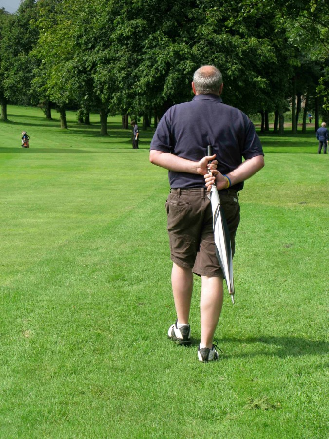 The gallery marches purposefully up the fairway